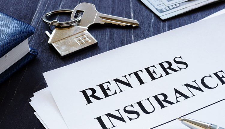 Renters Insurance policy agreement and key from apartments.